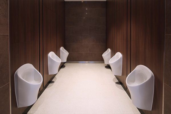 Concerto integrated duct panel system behind the WCs and urinals