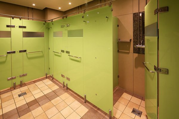 Luminoso glass shower cubicles in green installed at Reebok Sports Club