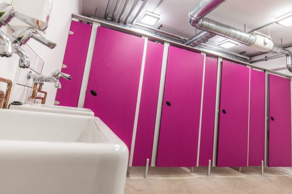 Mezzo toilet cubicles in pink for Crate Loughton.