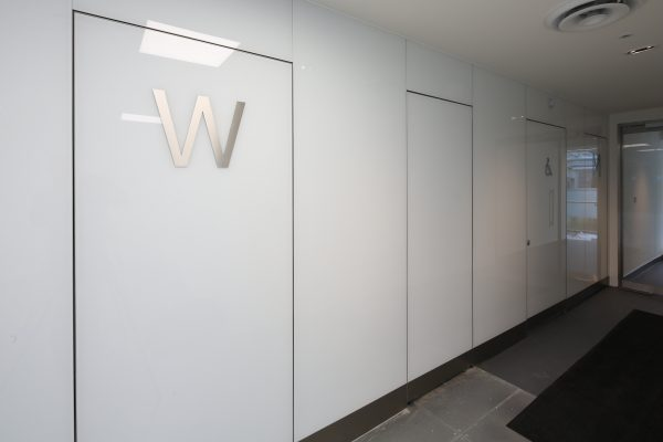 Washrooms to match common areas -external door sets as well as a full glass fascia wall to the exterior of the washrooms at Two London Bridge