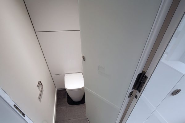 Full height Alto Kristalla toilet cubicles feature a unique rebated edge design for a flush façade - 50 Jermyn Street