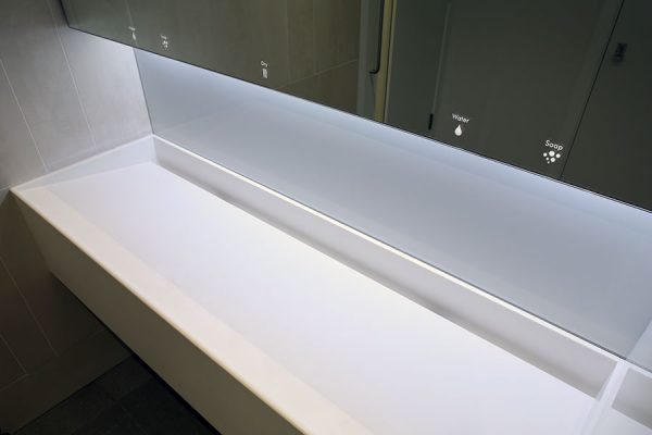 Dolphin Alavo and sloping white corian trough vanities - 50 Jermyn Street