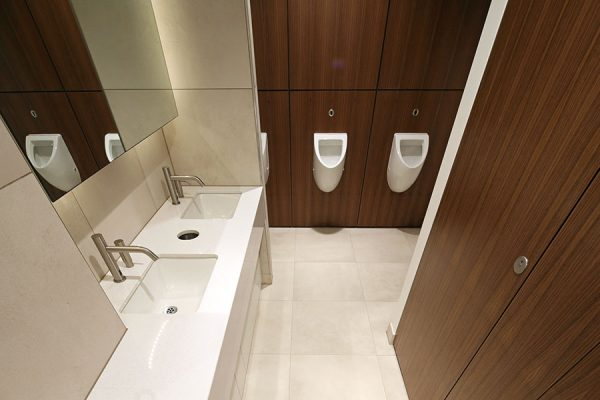 Full height, flush front Alto toilet cubicles and white Zodiac stone vanities at Heathrow Approach