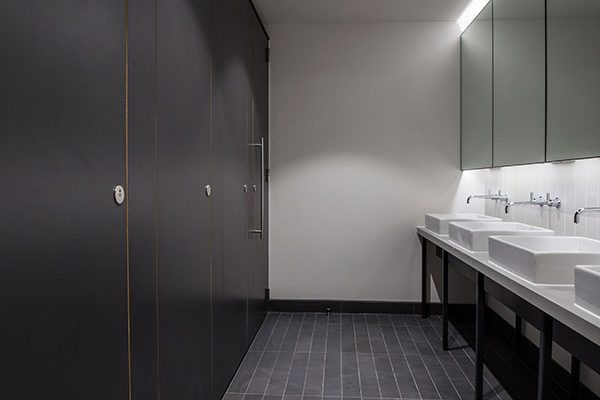Bespoke vanity design and full height flush front toilet cubicles with a virtually seamless façade - 33 Queens Street