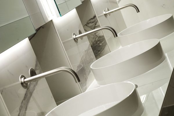 Marble units with illuminated mirrors and top mount basins - 20 North Audley Street