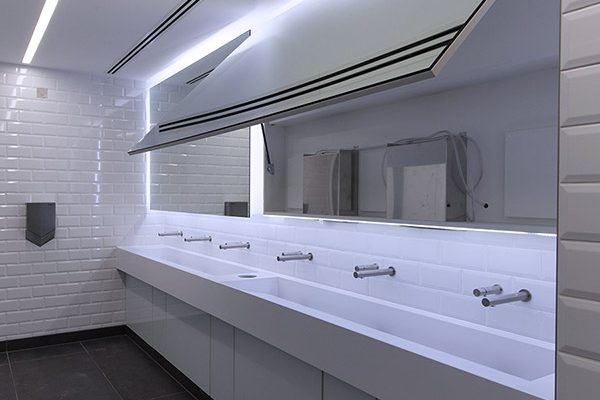 Corian trough vanities with Tego hinged mirror unit