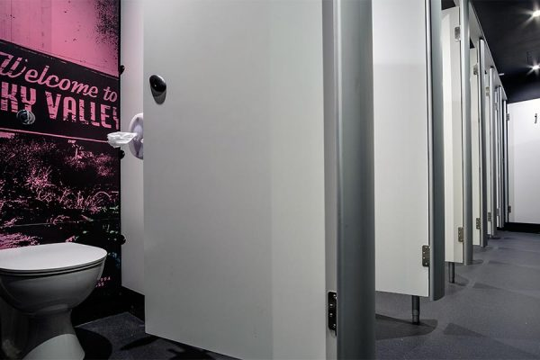 Mezzo toilet cubicles, each one with a different graphic printed to the duct panels - Borderline Soho