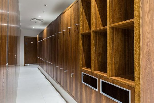 Octave lockers finished with a dark oak real wood veneer - Clarges Street, London