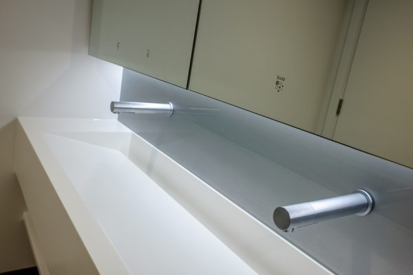 New Bracken House Corian trough style vanity units and Tego