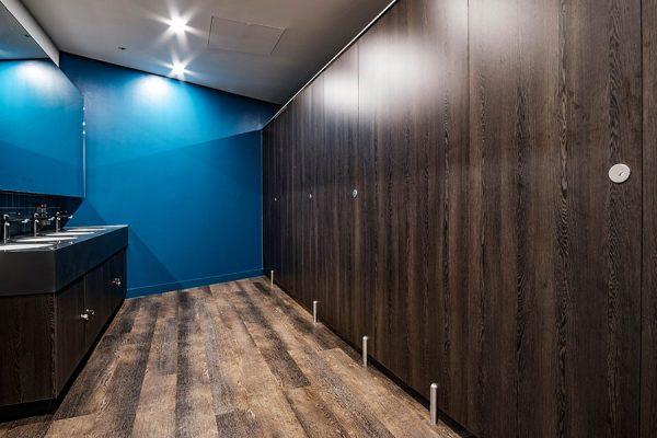 Marcato flush fascia solid grade laminate cubicles in dark woodgrain - Camm and Hopper