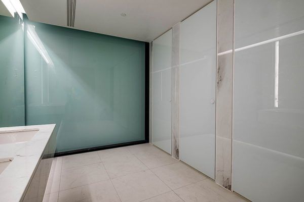 Alto bespoke cubicles with doors faced in painted back toughened glass at Principal Tower