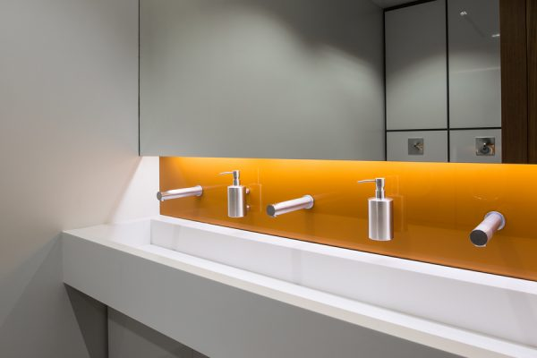 Vibrant orange glass splashback