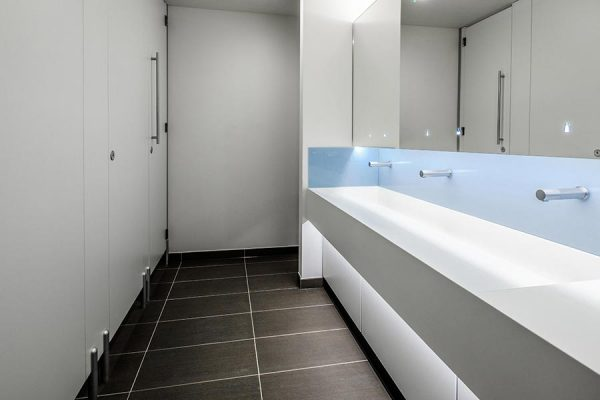 Marcato HPL toilet cubicles, Corian trough-style vanity units and Tego hinged mirror system - Ziggy Stardust office project