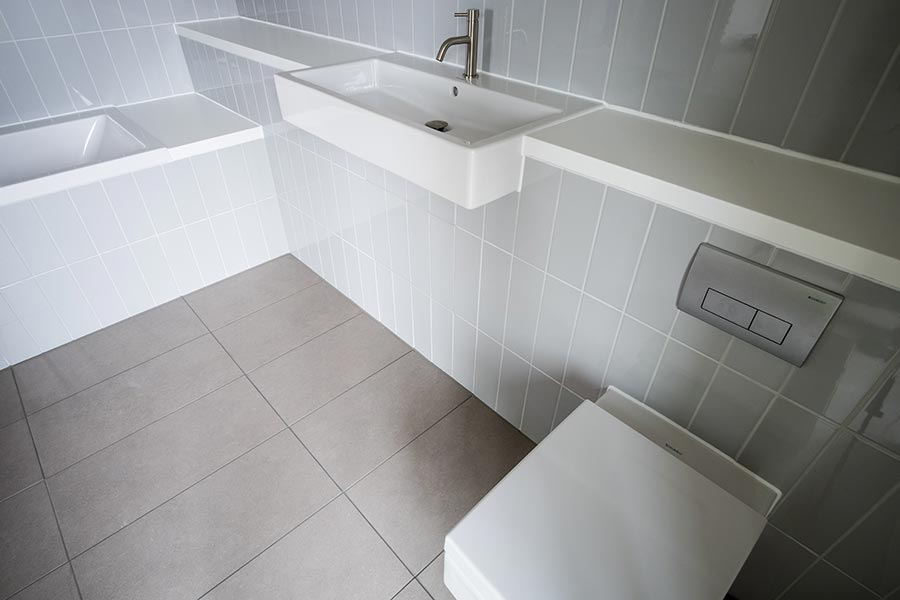 Parnell house bathroom with Corian vanity units