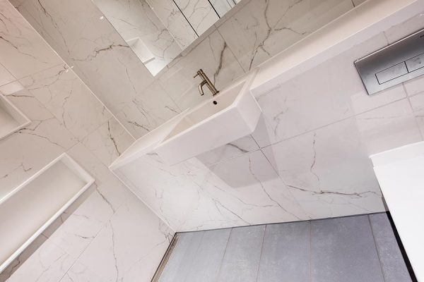 Parnell House bathroom finished in a white marble effect