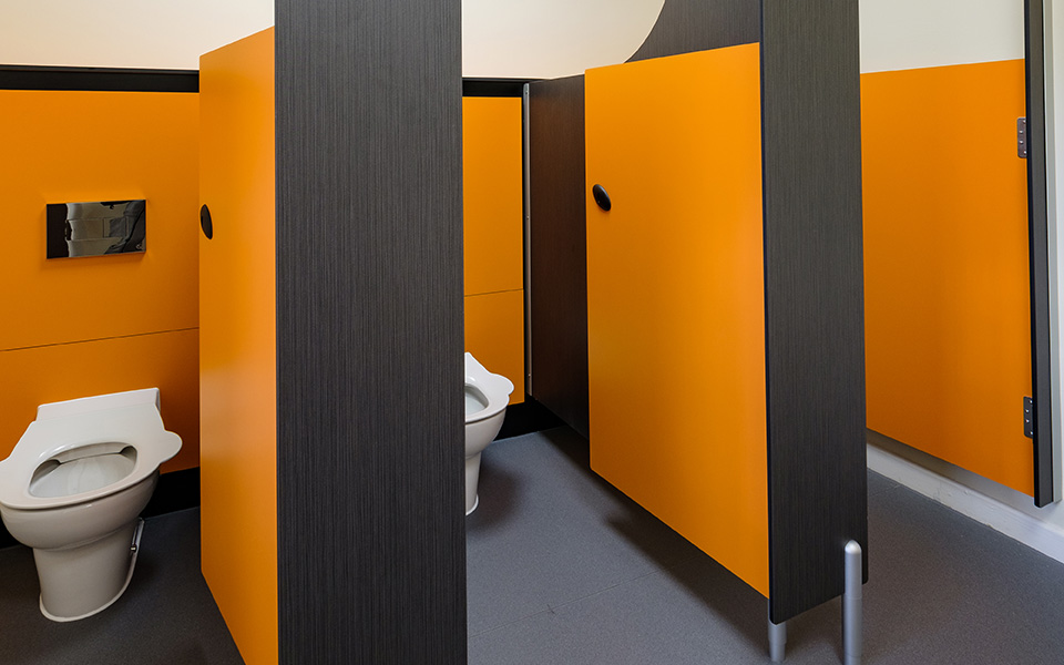 Sutton Sports Village - orange toilet cubicles