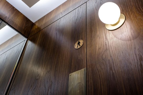 Full height Alto toilet cubicles with a natural fumed oak veneer finish - Kent House, London