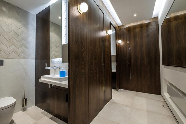 Alto cubicles and under vanity panels in a natural fumed oak veneer finish - Kent House, London