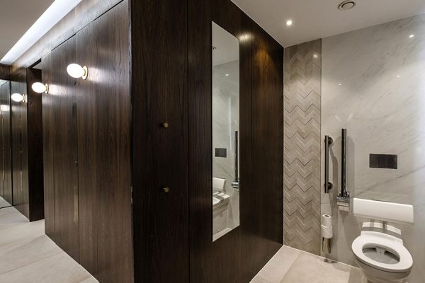 Alto toilet cubicles with a natural fumed oak veneer finish - Kent House, London