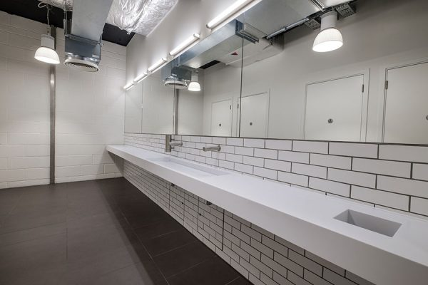 Arpeggio Corian trough-style vanity units in white - Devonshire Square, London