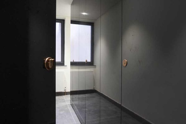 Alto full height toilet cubicles in high gloss grey laminate for CapCo