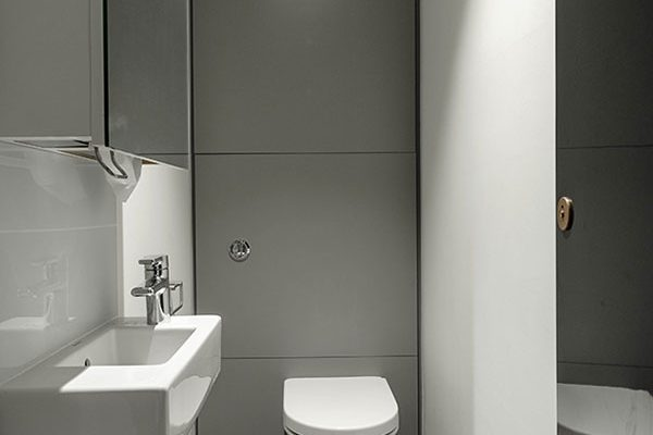 Toilet cubicle with grey high pressure laminate duct panels for CapCo