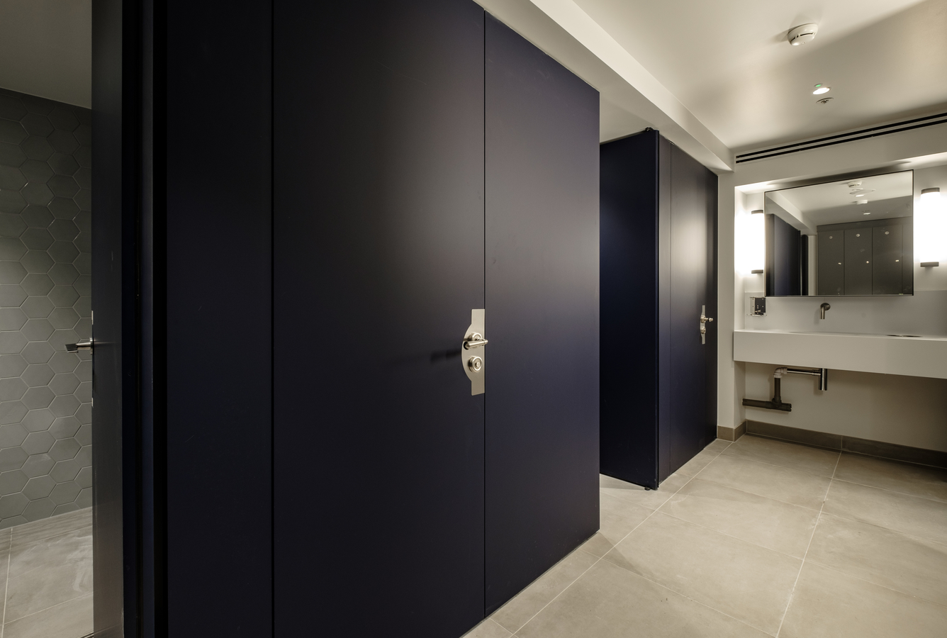 Blue Fenix laminate shower cubicles