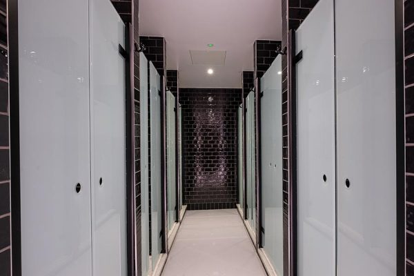 Luminoso glass saloon style shower cubicles - Barry's Bootcamp, Victoria