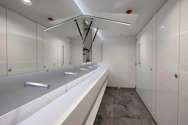 Corian trough vanity units and Tego hinged mirrors - New Bracken House