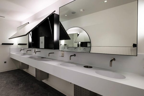 Arpeggio Corian vanity tops and Tego hinged mirrors - Park House