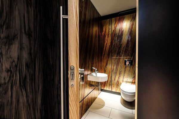Alto toilet cubicles with copper effect duct panelling - Sky Bar