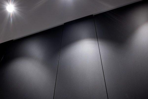 Close-up of black FENIX laminate Marcato cubicle doors