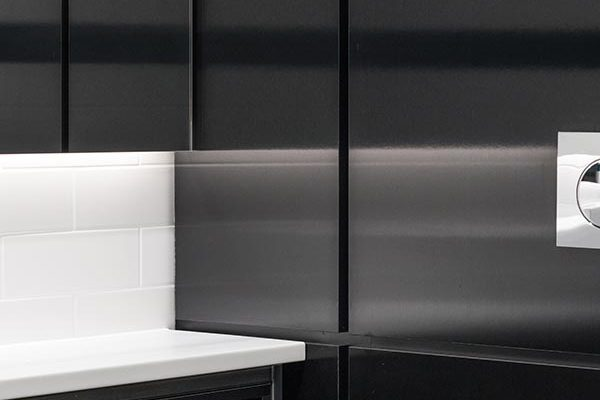 Duct panels in black brushed metallic effect high pressure laminate at 20-23 Mandela Street, London