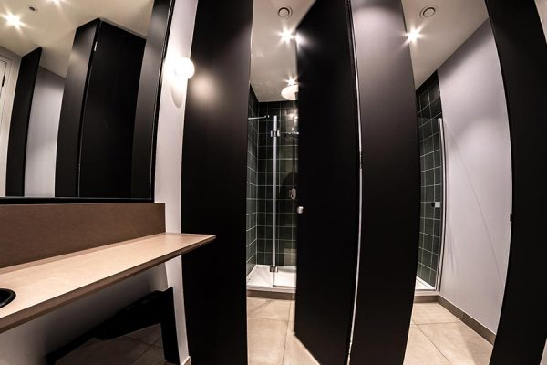 Marcato shower cubicles finished with black FENIX laminate