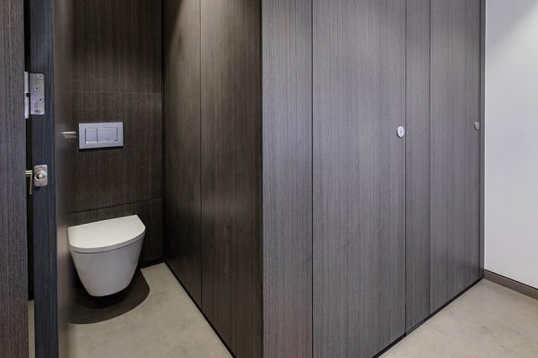 Alto full height toilet cubicles with dark wood effect high pressure laminate at 12 Arthur Street, London