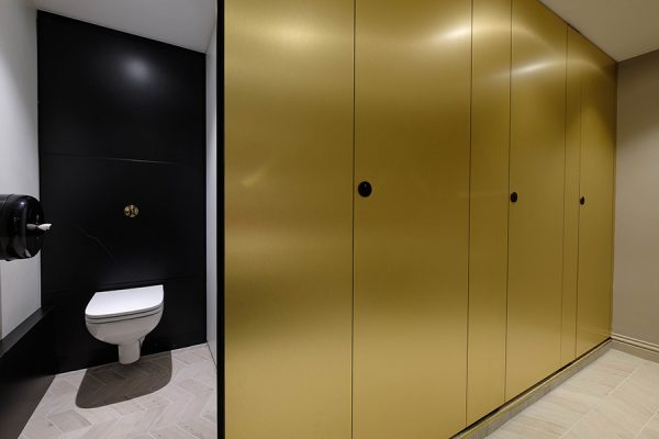 Alto full height with brass-effect laminate toilet cubicles at Dominion Theatre, London