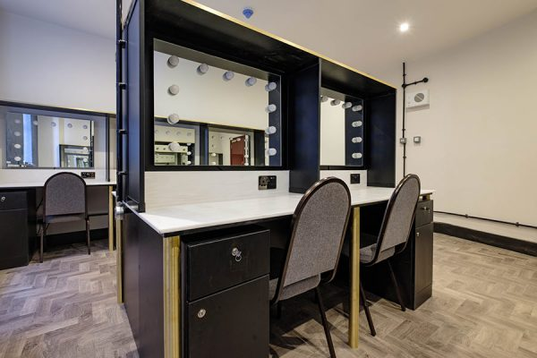 Corian solid surface dressing tables and mirror display units at Dominion Theatre, London