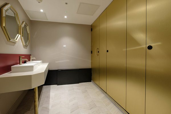 Luxurious red and gold colour scheme washroom at Dominion Theatre, London