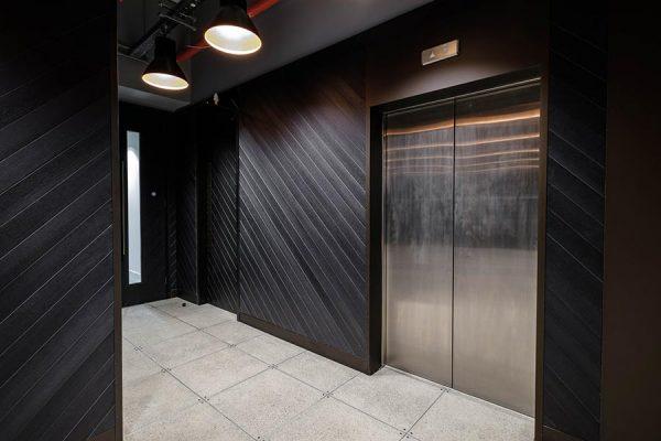 Bespoke lift lobby panels - 133 Houndsditch