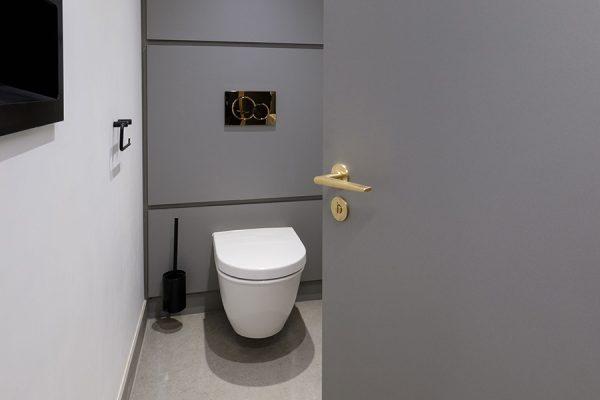 Alto toilet cubicle doors in grey high pressure laminate - One Kingsway