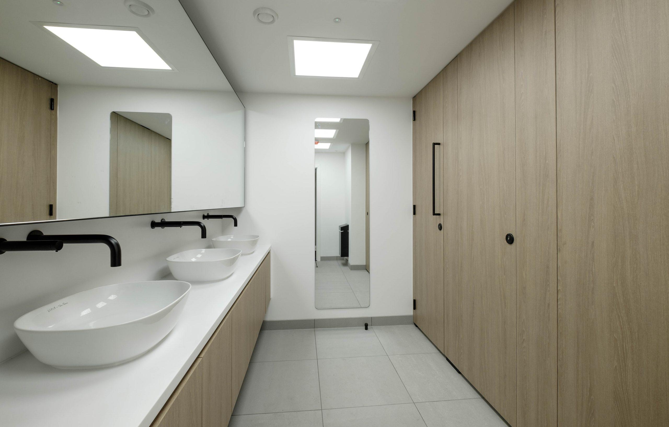 Washroom HQ female toilets woodgrain laminate