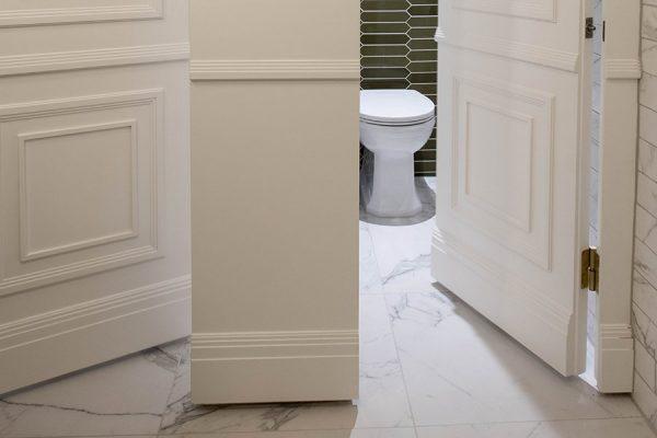 White bespoke timber mouldings and retro green tiles - Hammer House, London
